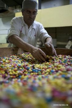 A worker selects candies to stuff chocolate Easter eggs preparing for Holy Week at the company of Chocolate Arrufat in Buenos Aires, capital of Argentina, on March (Photo/Xinhua) March Equinox, A Moveable Feast, Jesus Resurrection, Holy Week, Lifestyle News, New Testament, Latin America, Lent, Candies