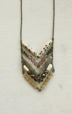Chevron necklace of bone, glass, brass, stone,