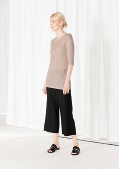 A body-hugging fit and a ribbed texture with ladder lace details makes this semi-transparent top a great piece for layering.