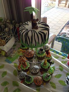 Safari themed cake and cupcakes with edible figurines