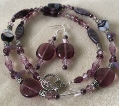 A personal favourite from my Etsy shop https://www.etsy.com/au/listing/483467764/amethyst-and-burgundy-swarovski-set