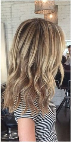 Gorgeous dirty blonde hair color, would look great as natural highlights on a dark brown base.