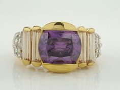 """There are some minor scratches on the ring.<br/><br/>Featured here is an elegant Laura Ramsey gold vermeil sterling silver ring with a round cut Amethyst main stone setting. Stone: Amethyst CZ. Stamp: China, 925, LR, CZ. Metal: Sterling Silver. Top Dimension: ½"""". 
