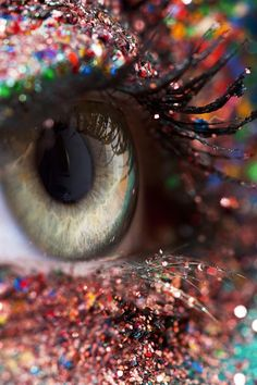""" an eye with glitter so definite it stung it and distorted its vision from black and white to a rainbow of colours """