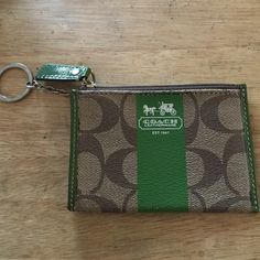 Coach coin pouch Khaki & green zipper Coach coin purse with keyring. Outside pocket perfect for card storage. Great condition! Coach Accessories Key & Card Holders