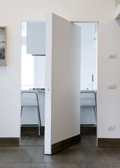 Vertical Pivot System door by the invisible door specialists at the Italian company L'Invisibili.