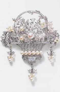 Flower basket breast ornament, by Cartier New York, circa 1918. Platinum, hexagonal, half-moon, square, round old- and single-cut diamonds, natural pearls, millegrain setting for the basket.