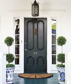 Black front door with lovely, deep blue accents.