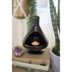 Kalalou Ceramic Retro Fireplace Tealight Holder. Take a trip back to the 1960's with these retro candle holders. Modeled after the classic fireplaces of mid century designer homes, these clever throwbacks hold tea light candles and will add touch a vintage charm to your bookshelf or mantle.