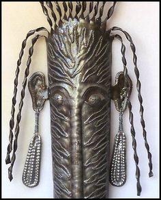 Ethnic mask designs in Haitian metal art - Steel drum wall decor. Metal Wall Sculpture, Steel Sculpture, Wall Sculptures, Metal Yard Art, Metal Wall Decor, Drums Art, Haitian Art, Metal Drum, Oil Drum