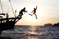 jumping off the boat and into the lake for a sunset swim...