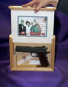 The only thing I can see wrong with this GLORIOUS gun hiding picture frame is that there isn't a picture of Jesus holding and American flag in the frame. Sad.