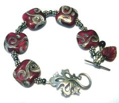 One of a Kind Sterling Silver Lampwork Glass and by bijoullery, $109.00  Blood RED w/lots o' sterling!
