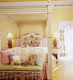 Wow - this yellow bedroom with red accents is so very pretty