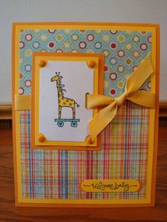 Baby Giraffe - not crazy about the papers but like the design! Little Hellos, Short & Sweet Paper: Naturals White, Summer Sun, Pumpkin Pie, DP by My Minds Eye Ink: Memento Tuxedo Black Accessories: American Crafts Ribbon, Misc Orange Brads, Ticket Corner Punch, Horizontal Slot Punch   Read more: http://www.splitcoaststampers.com/gallery/photo/1257955#ixzz2aNzaosvo