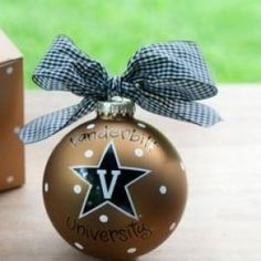 Any fan will love this Vanderbilt Logo Ornament. You'll be proud to showcase your school pride during the holiday season with this spirited ornament featuring the Vanderbilt logo and school colors! Each ornament is perfectly packaged with a matching gift box and coordinating tied ribbon for easy gift giving and safe storage.