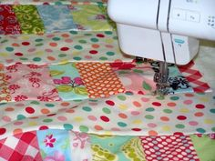 Need a baby quilt on short notice? Free pattern, good tutorial on quilt-as-you-go by Corrie and Des at quilttaffy.blogspot.com.