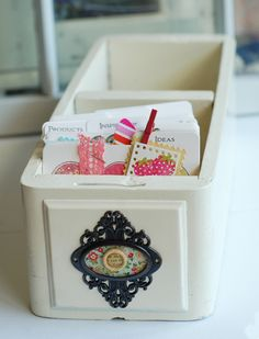 old sewing machine table drawer. Turn another drawer upside down on top, hing the back and use for a recipes box.