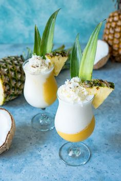 Golden Layered Piña Coladas for national pina colada day. Pineapple, mango and coconut layered with Koloa Gold and Coconut rums for a frosty tropical drink Refreshing Drinks, Summer Drinks, Chai Tea Recipe, Weight Watcher Smoothies, Alcohol Drink Recipes, Coconut Rum, Bar Drinks, Beverages, Fruit Smoothies