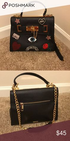 7eaea28f79b Shop Women s Aldo Black size OS Mini Bags at a discounted price at  Poshmark. Description  Uniquely designed with different logos on the front.