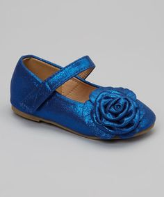 Tiny trendsetters will walk a stylish path dressed in this darling pair. A rosette applique sweetly charms the toe, while a hook and loop closure ensures easy on-off.