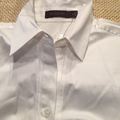 White dress shirt Brand-new white dress shirt from the limited still with tags. Small spots right by shoulder. See pics may come out when laundered. The Limited Tops Button Down Shirts