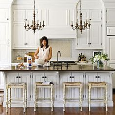 White Kitchens With Dark Floors - Bing Images love chandeliers over island.