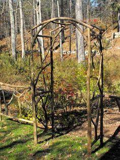 Branch trellis for entrance to veggie garden #gardenvinesarbors