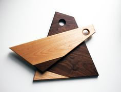 Charming 2 piece geometrical cutting board set, made out of solid black walnut and solid cherrywood. Hard Oil Finish (linseed oil + tung oil, does not contain water or solvents, it is solely made from natural oils and resins) Dimensions: Board 1: 14x11 1/2 Board 2: 16 1/2x6 Au plaisir, Caroline & Martin