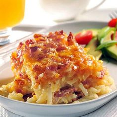 Potato Bacon Casserole  4 cups frozen shredded hash brown potatoes 1/2 cup finely chopped onion 8 ounces bacon or turkey bacon, cooked and crumbled 1 cup (4 oz.) shredded cheddar cheese 1 can (12 fl. oz.) evaporated milk 1 large egg, lightly beaten or 1/4 cup egg substitute 1 1/2 teaspoons seasoned salt Directions PREHEAT oven to 350° F. Grease 8-inch-square baking dish.  LAYER 1/2 potatoes, 1/2 onion, 1/2 bacon and 1/2 cheese in prepared baking dish; repeat layers. Combine evaporated milk, ...
