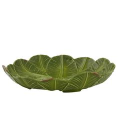 Banana Leaf Centerpiece Bowl Rafael Bordallo Pinheiro is one of the most influential people of the nineteenth century Portuguese culture. His gorgeous artistic stoneware is skillfully artisan made through several techniques and procedures, some steps dating centuries back, resulting in one of a kind exceptional quality.