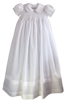 This memorable christening dress is embellished with stunning smocking, made from heirloom quality cotton Imperial Batiste. The bodice is fully smocked, with two rows of embroidered rosebuds made with