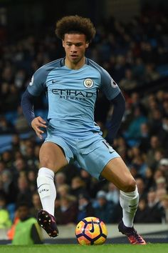 Manchester City's German midfielder Leroy Sane controls the ball during the English Premier League football match between Manchester City and Watford at the Etihad Stadium in Manchester, north west England, on December 14, 2016. / AFP / Paul ELLIS / RESTRICTED TO EDITORIAL USE. No use with unauthorized audio, video, data, fixture lists, club/league logos or 'live' services. Online in-match use limited to 75 images, no video emulation. No use in betting, games or single club/league/player…