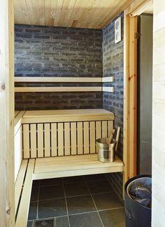 Hytte i Ål ved Vesle Bergsjø, 1100 moh. Arkitekt er Torbjørn Tryti. Bildet viser hyttas badstue hvor den svarte teglsteinen står i fin kontrast til den lyse kledningen i osp.
