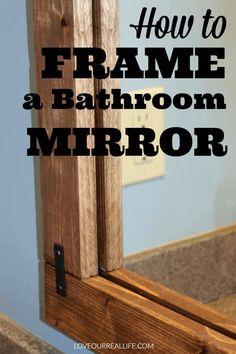 Framing a builder's grade bathroom mirror is an easy way to update your bathroom on a budget. A full tutorial is here. #bathroomdecor #framedmirror #bathroom