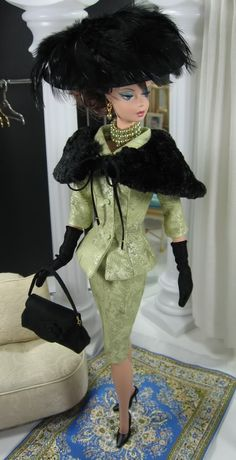 Mad Men - Peggy; Also Barbie inspired for Eulalie MacKecknie Shinn!  Hot cha! Love it! Ohh that hat!  Oooh the black gloves!  Oooh the layered pearls!  Oooh that suit!  Oooh that shawl!  Ooooh love love love it!  Vintage Barbie, thanks for the sotto voce eyes!!