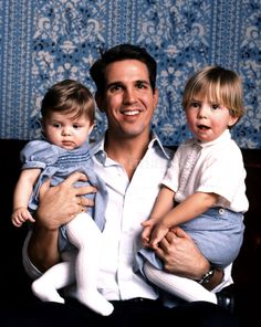 Crown Prince Pavlos with his 2 eldest sons, Prince Constantine-Alexios (R), and Prince Achileas-Andreas, looking very much like a girl.