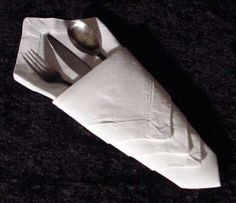 Napkin folding for the holidays The Diamond Pouch Here we have another variation of the silverware pouch. Also simple to make, this design tends to look nicer when it is pressed down almost flat. You wouldn't want your silverware getting cold, would you?