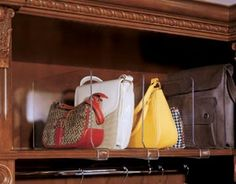 First off, for storing your high end bags I recommend a shelf system with divider supports. You can use these stylish clear Acrylic Shelf Dividers or more practical metal ones. The reason I recommend a shelf system is because long term storage by hanging can eventually damage(stretch) the strap.