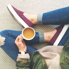 Relaxed neutrals with red sneaks + green jacket