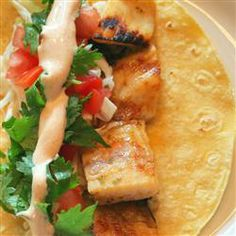 Grilled Fish Tacos with Chipotle-Lime Dressing   Be careful—the dressing on these fish tacos is so good, it might take over the whole meal.