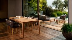 Outdoor furniture by Tribù. Mood collection dining table and armchairs.