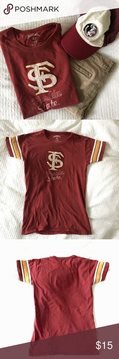 """FSU Seminoles T-Shirt Excellent shape FSU shirt. Worn once. The FS and stripes on the arm are sewn on. """"Florida State"""" on the front is printed. Shirt looks really vintage and has no holes, tears, or stains. Fits a little small! Size says medium but is a bit tight on me and I usually wear a small. Banner '47 Tops Tees - Short Sleeve"""