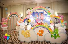 The 3D photo booth and entrance decor for a Care Bears themed birthday party. Design and setup by ParteeBoo - The Party Designers.