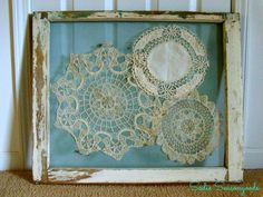 """GREAT idea using an old window & doilies (even yellowed) for framed """"art""""."""