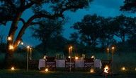 Dining under the star studded skies of South Africa provide for a memorable dining experience at Sir Richard Branson's Ulusaba Game Lodge. Game Lodge, Private Games, Kruger National Park, Game Reserve, Under The Stars, World Famous, The Rock, South Africa, Safari