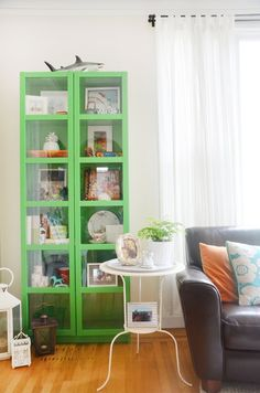 The green bookcase is from IKEA. It's filled with gifts from family and friends and memories of her travels.