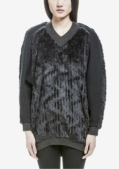 91dbe5ef36 Fabulous oversized knit sweater with V-neck and cozy faux fur details at  front and