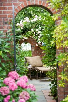 We wouldn't be opposed to relaxing in the quiet comforts of this secluded garden corner. - Traditional Home ® / Photo: John Granen