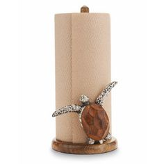Spice up your coastal kitchen with this Sea Turtle Paper Towel Holder made of mango wood.